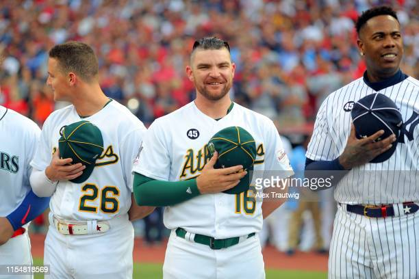 Liam Hendriks of the Oakland Athletics looks on during the singing of the national anthem prior to the 90th MLB AllStar Game at Progressive Field on...