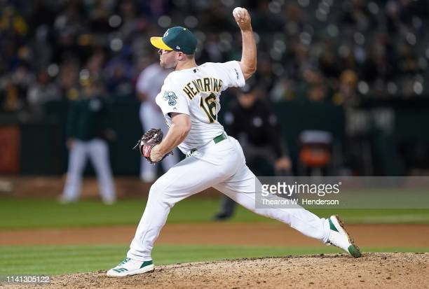 Liam Hendriks of the Oakland Athletics pitches against the Boston Red Sox in the top of the seventh inning at OaklandAlameda County Coliseum on April...