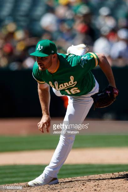 Liam Hendriks of the Oakland Athletics pitches against the Chicago White Sox during the ninth inning at the RingCentral Coliseum on July 14 2019 in...