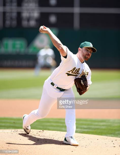 Liam Hendriks of the Oakland Athletics pitches against the Los Angeles Angels at OaklandAlameda County Coliseum on May 29 2019 in Oakland California