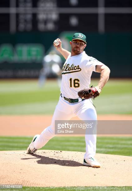 Liam Hendriks of the Oakland Athletics pitches against the Los Angeles Angels in the first inning at OaklandAlameda County Coliseum on May 29 2019 in...