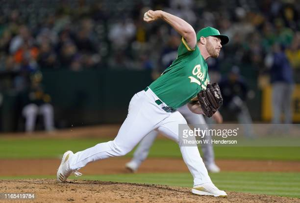 Liam Hendriks of the Oakland Athletics pitches against the Milwaukee Brewers in the top of the eighth inning at Ring Central Coliseum on July 30 2019...