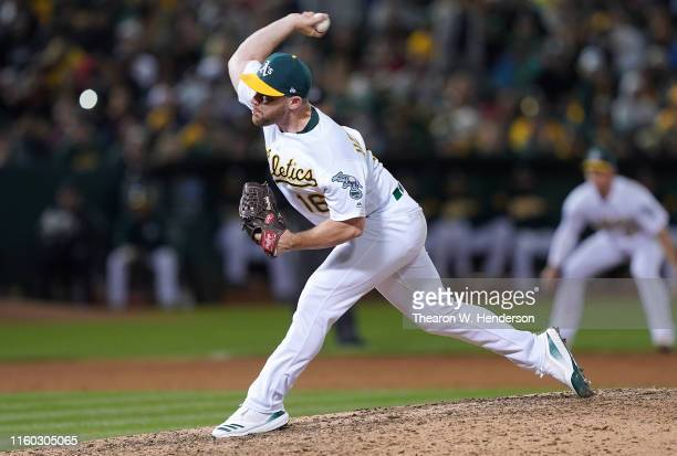 Liam Hendriks of the Oakland Athletics pitches against the Minnesota Twins in the top of the ninth inning at OaklandAlameda County Coliseum on July 3...