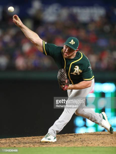 Liam Hendriks of the Oakland Athletics pitches against the Texas Rangers during game two of a doubleheader at Globe Life Park in Arlington on June 08...