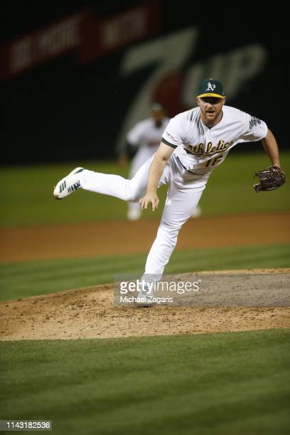 Liam Hendriks of the Oakland Athletics pitches during the game against the Boston Red Sox at the OaklandAlameda County Coliseum on April 1 2019 in...