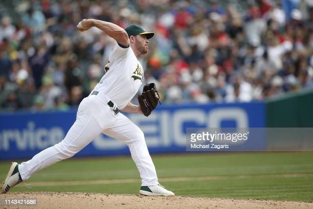 Liam Hendriks of the Oakland Athletics pitches during the game against the Boston Red Sox at the OaklandAlameda County Coliseum on April 4 2019 in...