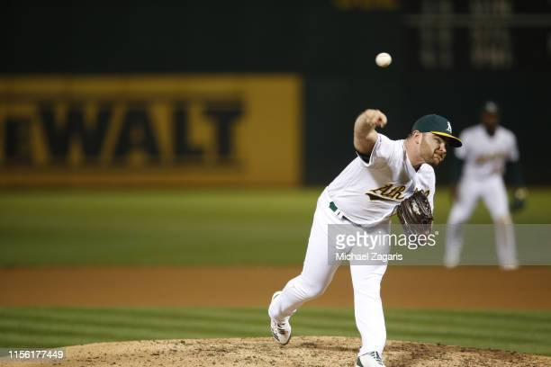 Liam Hendriks of the Oakland Athletics pitches during the game against the Los Angeles Angels of Anaheim at the OaklandAlameda County Coliseum on May...