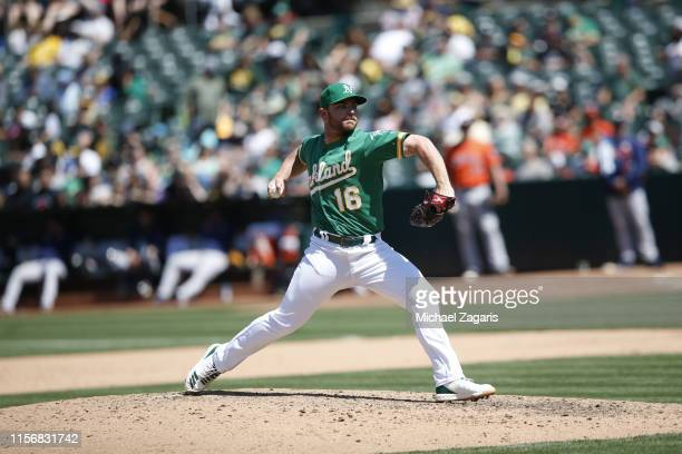 Liam Hendriks of the Oakland Athletics pitches during the game against the Houston Astros at the OaklandAlameda County Coliseum on June 2 2019 in...