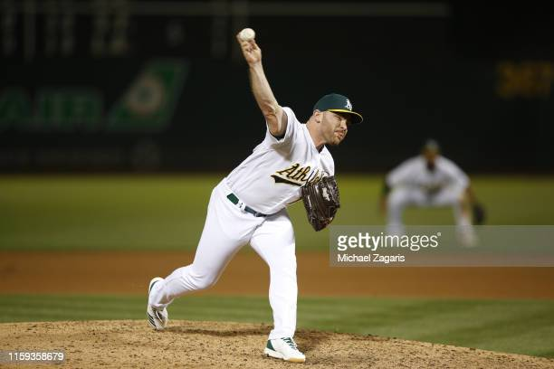Liam Hendriks of the Oakland Athletics pitches during the game against the Baltimore Orioles at the OaklandAlameda County Coliseum on June 17 2019 in...