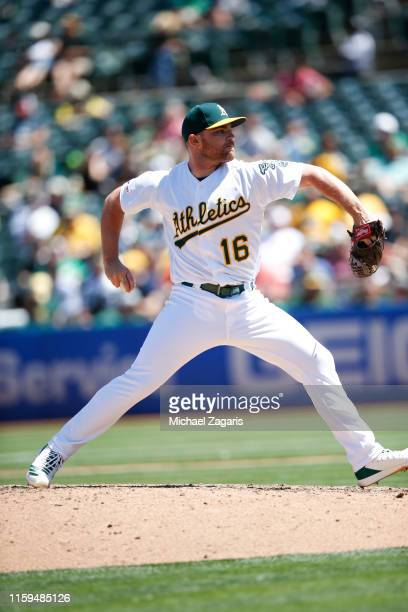 Liam Hendriks of the Oakland Athletics pitches during the game against the Baltimore Orioles at the OaklandAlameda County Coliseum on June 19 2019 in...