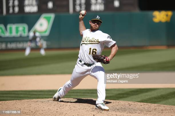 Liam Hendriks of the Oakland Athletics pitches during the game against the Tampa Bay Rays at the OaklandAlameda County Coliseum on June 22 2019 in...