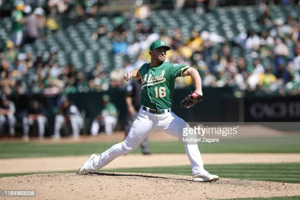 Liam Hendriks of the Oakland Athletics pitches during the game against the Chicago White Sox at the OaklandAlameda County Coliseum on July 14 2019 in...