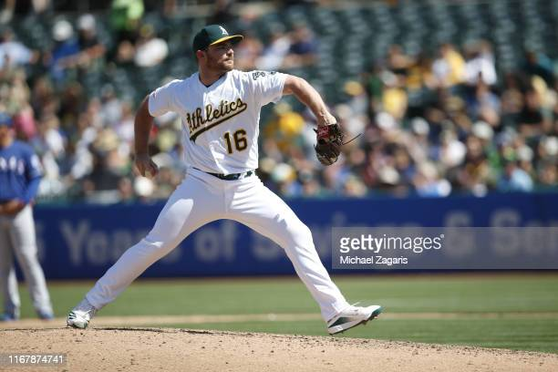 Liam Hendriks of the Oakland Athletics pitches during the game against the Texas Rangers at the OaklandAlameda County Coliseum on July 28 2019 in...