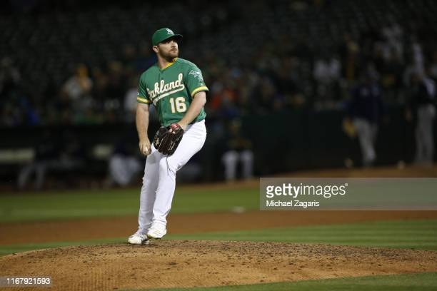 Liam Hendriks of the Oakland Athletics pitches during the game against the Milwaukee Brewers at the OaklandAlameda County Coliseum on July 30 2019 in...