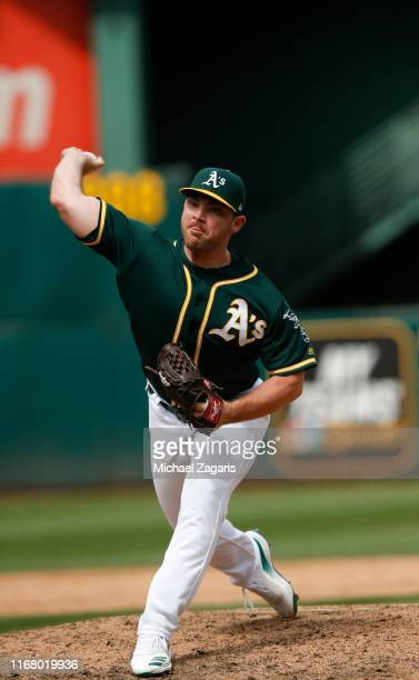 Liam Hendriks of the Oakland Athletics pitches during the game against the Milwaukee Brewers at the OaklandAlameda County Coliseum on August 1 2019...