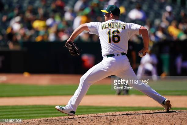 Liam Hendriks of the Oakland Athletics pitches during the ninth inning against the Tampa Bay Rays at OaklandAlameda County Coliseum on June 22 2019...