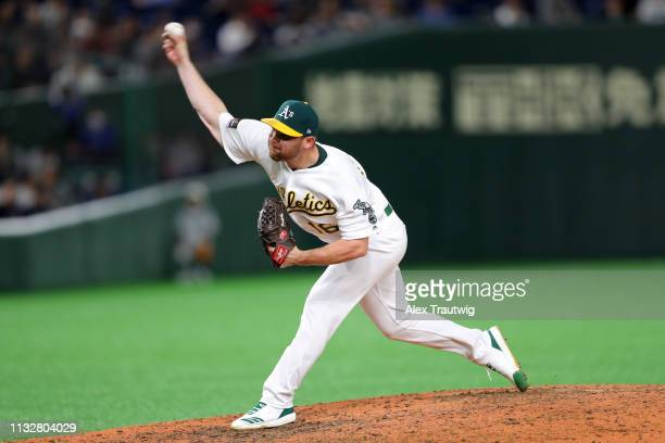 Liam Hendriks of the Oakland Athletics pitches in a game against the Seattle Mariners during the 2019 Opening Series at the Tokyo Dome on Thursday...