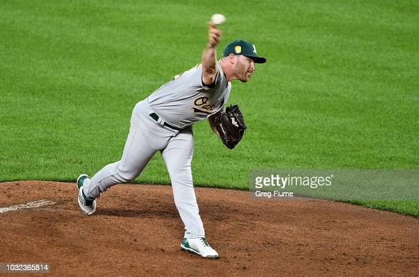 Liam Hendriks of the Oakland Athletics pitches in the first inning against the Baltimore Orioles at Oriole Park at Camden Yards on September 12 2018...