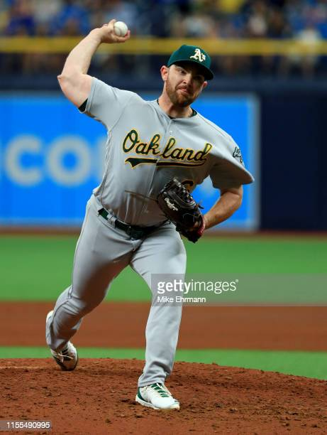Liam Hendriks of the Oakland Athletics pitches in the seventh inning during a game against the Tampa Bay Rays at Tropicana Field on June 12 2019 in...