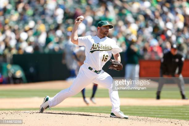 Liam Hendriks of the Oakland Athletics pitches in the top of the fourth inning against the Toronto Blue Jays at OaklandAlameda County Coliseum on...