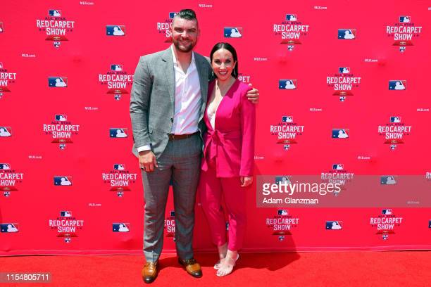 Liam Hendriks of the Oakland Athletics poses for a photo with his wife Kristi Hendriks during the MLB Red Carpet Show presented by Chevrolet at...