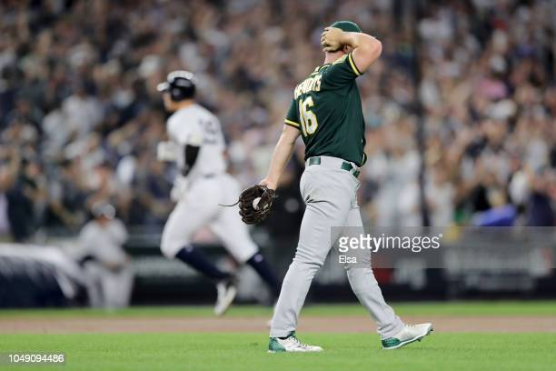 Liam Hendriks of the Oakland Athletics reacts after giving up a two run home run to Aaron Judge of the New York Yankees during the first inning in...