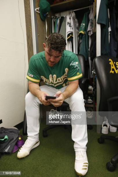 Liam Hendriks of the Oakland Athletics relaxes in the clubhouse following the game against the Chicago White Sox at the OaklandAlameda County...
