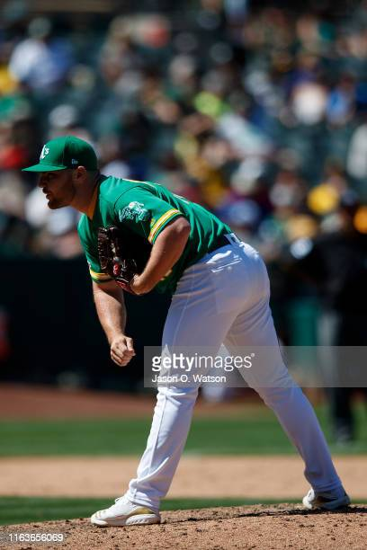 Liam Hendriks of the Oakland Athletics stands on the pitchers mound against the Chicago White Sox during the ninth inning at the RingCentral Coliseum...