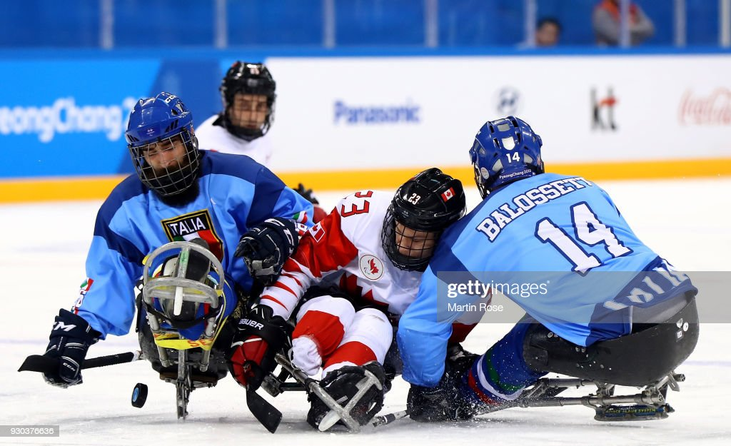Liam Hickey #23 of Canada battles for the puck with Bruno Balossetti #14 of Italy in the Ice Hockey Preliminary Round - Group A game between Canada and Italy during day two of the PyeongChang 2018 Paralympic Games on March 11, 2018 in Gangneung, South Korea.