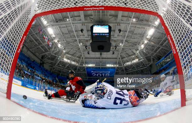 Liam Hickey of Canada fails to score over Steve Cash goaltender of United States in the Ice Hockey gold medal game between Canada and United States...