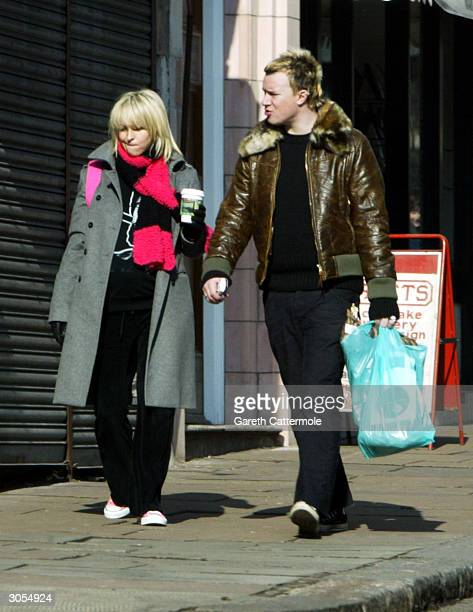 Liam Howlett and Natalie Appleton walk together March 3 2004 in North London Natalie gave birth to a baby boy today and the couple have named him Ace