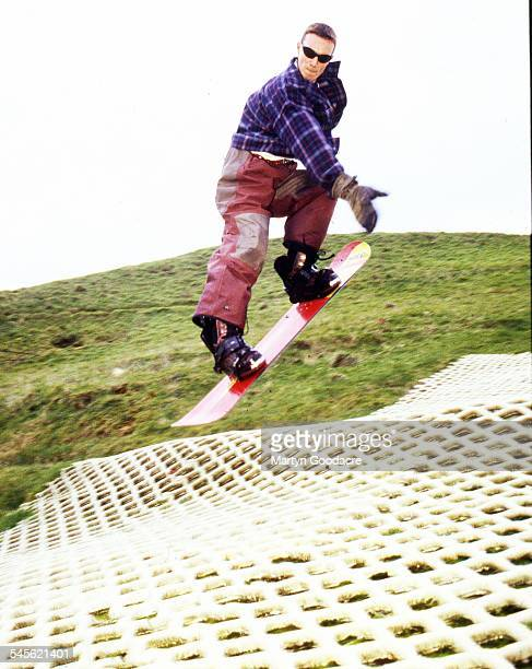 Liam Howlett of The Prodigy snowboarding at a dry ski slope United Kingdom 1993