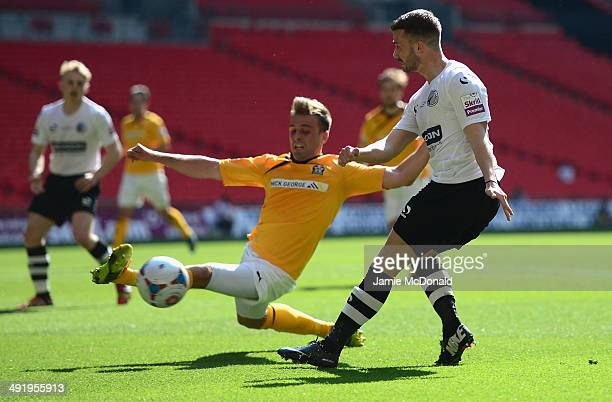 Liam Hughes of Cambridge United battles with Phil Turnbull of Gateshead United during the Skrill Conference Premier PlayOffs Final between Cambridge...
