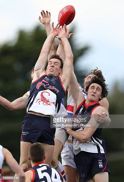 Liam Hulett and Oscar Mcinerney of Casey Scorpions compete for the ball during the VFL Qualifying Final match between Casey and Footscray at Casey...