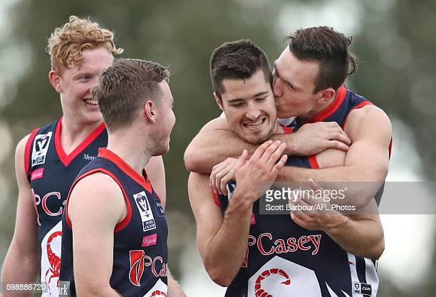 Liam Hulett of Casey Scorpions kisses his teammates after they won the VFL Qualifying Final match between Casey and Footscray at Casey Fields on...