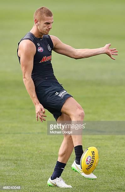 Liam Jones kicks the ball during a Carlton Blues AFL training session at Ikon Park on April 1 2015 in Melbourne Australia