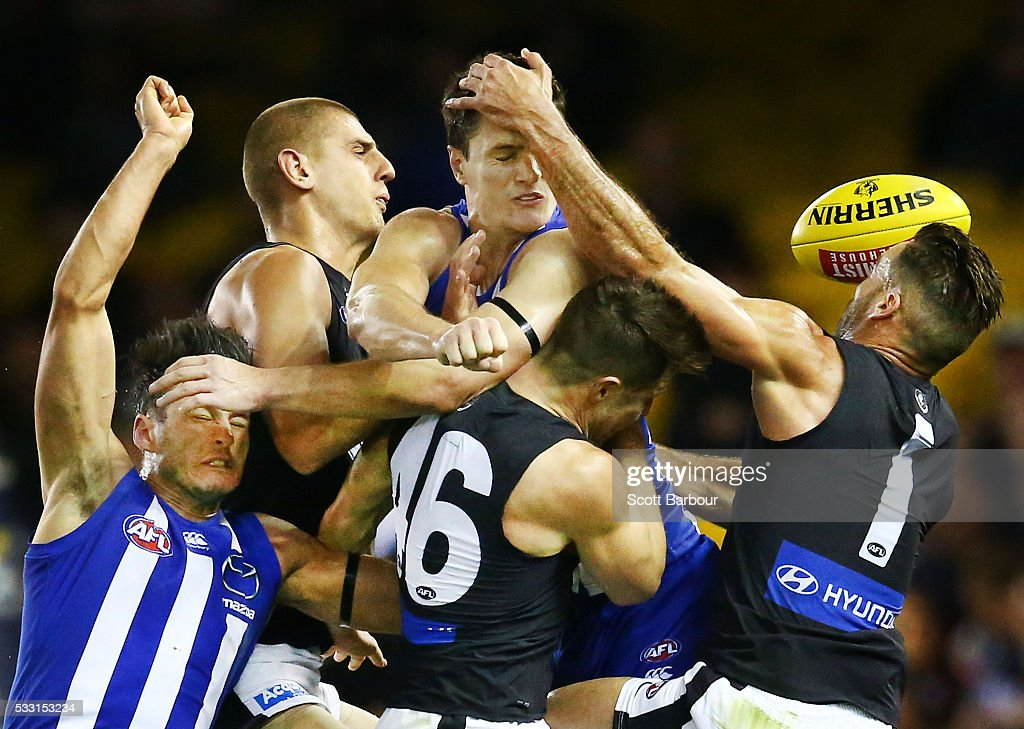 Liam Jones, Matthew Wright and Andrew Walker of the Blues along with Robbie Tarrant and Scott Thompson of the Kangaroos compete for the ball during the round nine AFL match between the North Melbourne Kangaroos and the Carlton Blues at Etihad Stadium on May 21, 2016 in Melbourne, Australia.