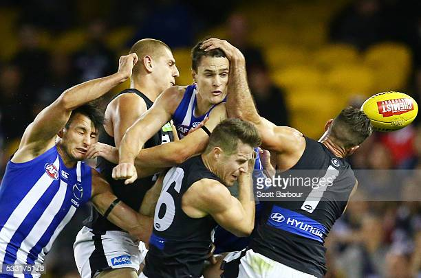 Liam Jones Matthew Wright and Andrew Walker of the Blues along with Robbie Tarrant and Scott Thompson of the Kangaroos compete for the ball during...