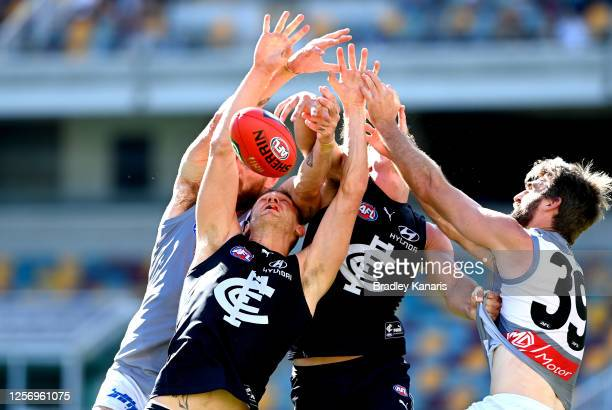 Liam Jones of Carlton and Justin Westhoff of Port Adelaide challenge for the ball during the round 7 AFL match between the Carlton Blues and the Port...