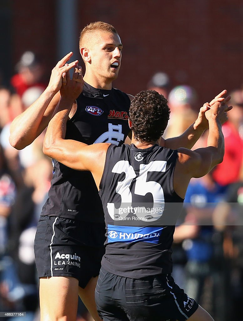 Liam Jones of the Blues is congratulated by Ed Curnow after kicking a goal during the NAB Challenge AFL match between the Collingwood Magpies and the Carlton Blues at Queen Elizabeth Oval on March 15, 2015 in Bendigo, Australia.
