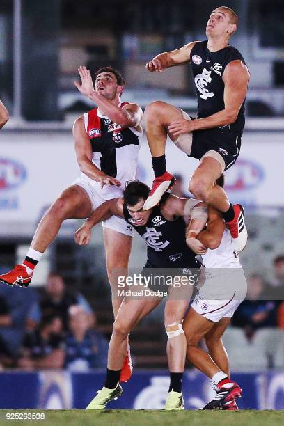 Liam Jones of the Blues leaps high early for a contest during the JLT Community Series AFL match between the Carlton Blues and the St Kilda Saints at...