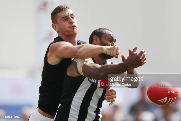 Liam Jones of the Blues punches the ball from Travis Varcoe of the Magpies during the 2019 JLT Community Series match between the Collingwood Magpies...