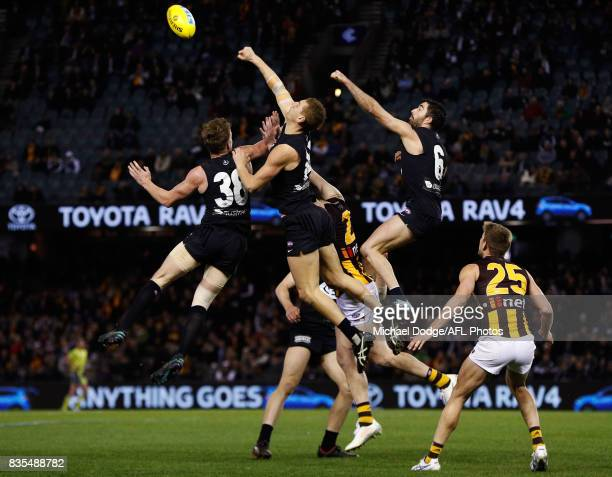 Liam Jones of the Blues spoils Jarryd Roughead of the Hawks during the round 22 AFL match between the Carlton Blues and the Hawthorn Hawks at Etihad...