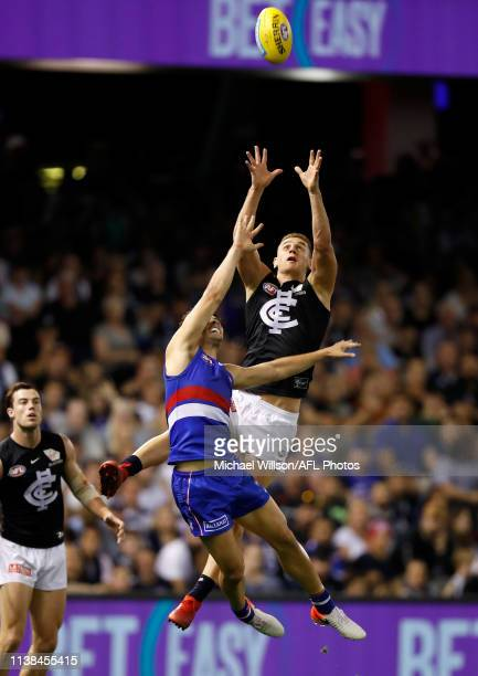Liam Jones of the Blues takes a high mark over Josh Dunkley of the Bulldogs during the 2019 AFL round 05 match between the Western Bulldogs and the...