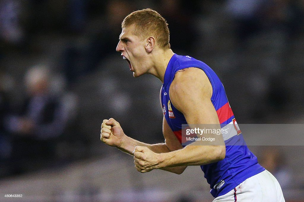 Liam Jones of the Bulldogs celebrates a goal during the round 13 AFL match between the Collingwood Magpies and the Western Bulldogs at Etihad Stadium on June 15, 2014 in Melbourne, Australia.