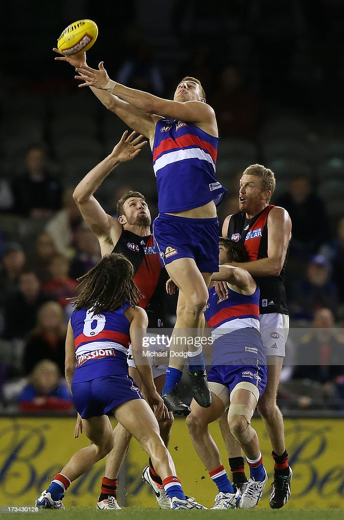 Liam Jones of the Bulldogs contests for the ball during the round 16 AFL match between the Western Bulldogs and the Essendon Bombers at Etihad Stadium on July 14, 2013 in Melbourne, Australia.