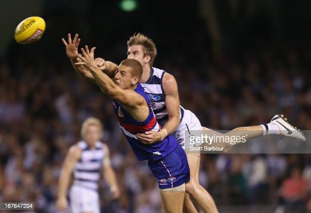 Liam Jones of the Bulldogs takes a mark in front of Tom Lonergan of the Cats during the round five AFL match between the Western Bulldogs and the...
