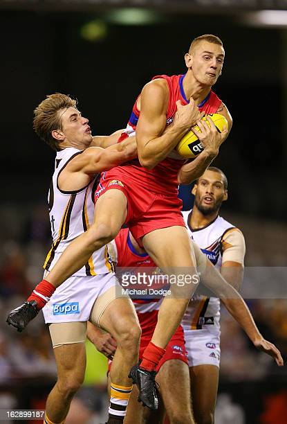 Liam Jones of the Western Bulldogs marks the ball against Ryan Schoenmakers of the Hawthorn Hawks during round two NAB Cup AFL match between the...