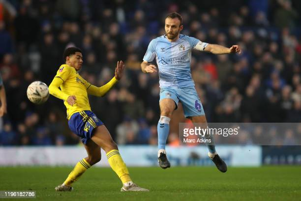 Liam Kelly of Coventry City in action with Jude Bellingham of Birmingham City during the FA Cup Fourth Round match between Coventry City and...