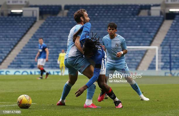Liam Kelly of Coventry City vies with Joe Aribo of Rangers during the pre season friendly match between Rangers and Coventry City at Ibrox Stadium on...